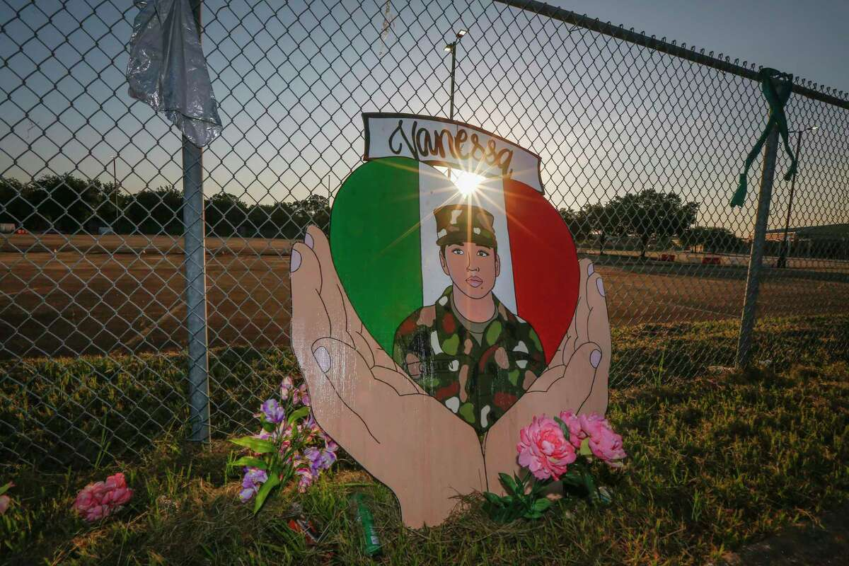 A small memorial for U.S. Army Specialist Vanessa Guillen is set up around Cesar Chavez High School Friday, Aug. 14, 2020, in Houston.