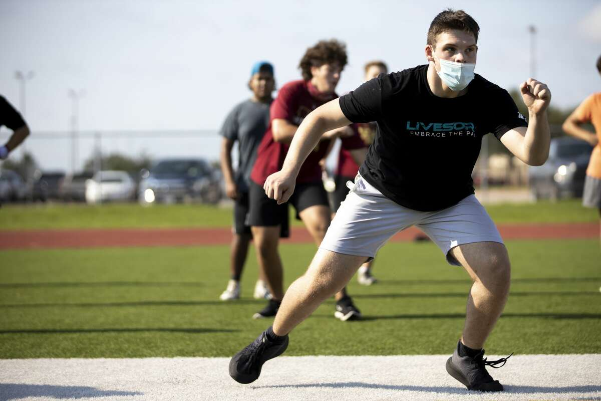Aidan Ivey, center for the Cypress Woods High School football team, practices during training at Cypress Woods High School, Wednesday, August 5, 2020. They team has adopted some social distancing practices during training.