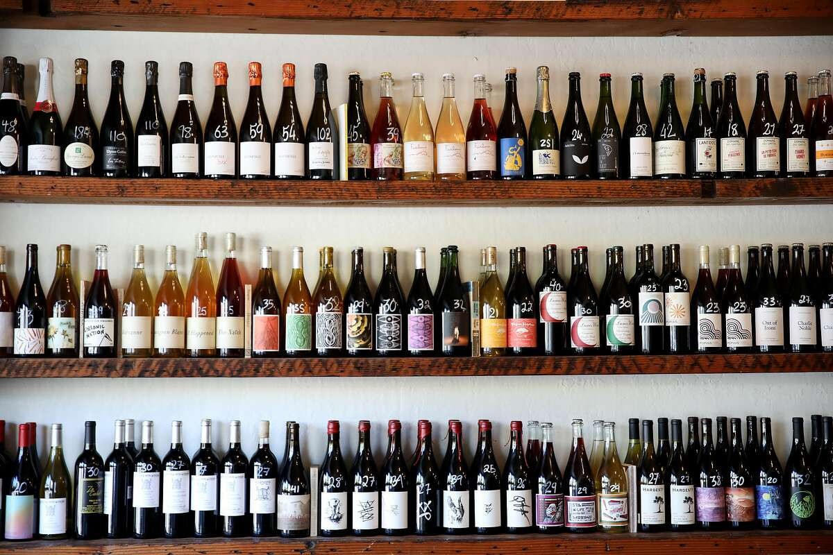 A variety of wines sit on shelves at Ordinaire Wine Shop and Wine Bar, located at 3354 Grand Ave., on Friday, July 10, 2020, in Oakland, Calif. Jirka Jireh, a manager and sommelier at Ordinaire Wine Shop and Wine Bar, has begun organizing virtual wine classes for BIPOC across the country; the classes are free for all students, with the instructor donating time and wine companies donating all the wine.