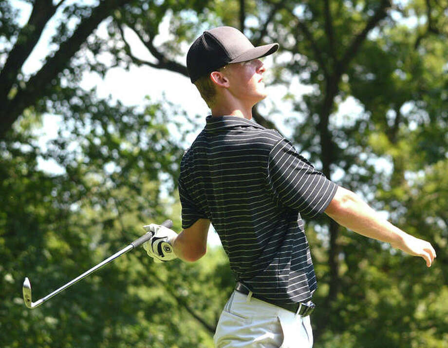 Edwardsville's Hayden Moore watches his iron shot during a tournament last season. Moore is expected to be the No. 1 golfer this season for the Tigers. Photo: Scott Marion|The Intelligencer