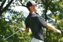 Edwardsville's Hayden Moore watches his iron shot during a tournament last season. Moore is expected to be the No. 1 golfer this season for the Tigers.