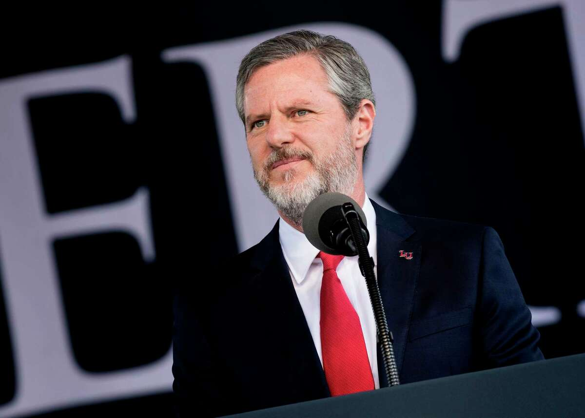 In this file photo taken on May 13, 2017, President of Liberty University, Jerry Falwell, Jr., speaks during Liberty University's commencement ceremony in Lynchburg, Virginia. - Falwell, a vocal supporter of US President Donald Trump, has taken an indefinite leave of absence as president of the evangelical university amid a furor over an Instagram picture of him and a young woman, both with pants partly unzipped. He himself had posted the controversial picture showing him standing on a private yacht with one hand around the waist of a young woman -- later said to be his wife's assistant -- and the other holding an unidentified dark beverage. Both sport broad smiles and have their zippers a few inches down, baring their midriffs.