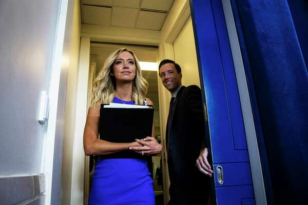 White House press secretary Kayleigh McEnany arrives before a coronavirus briefing in the White House on Aug 13.
