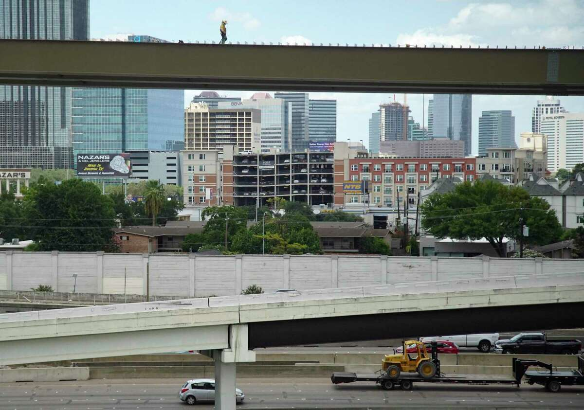 A construction worker makes his way down a freeway ramp at Loop 610 and Interstate 69 in Houston on Aug. 10, 2020.