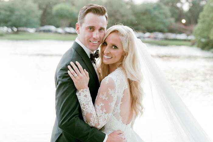 Dr. Elizabeth McIngvale and Matthew Mackey tie the knot at Houston Oaks on July 18.