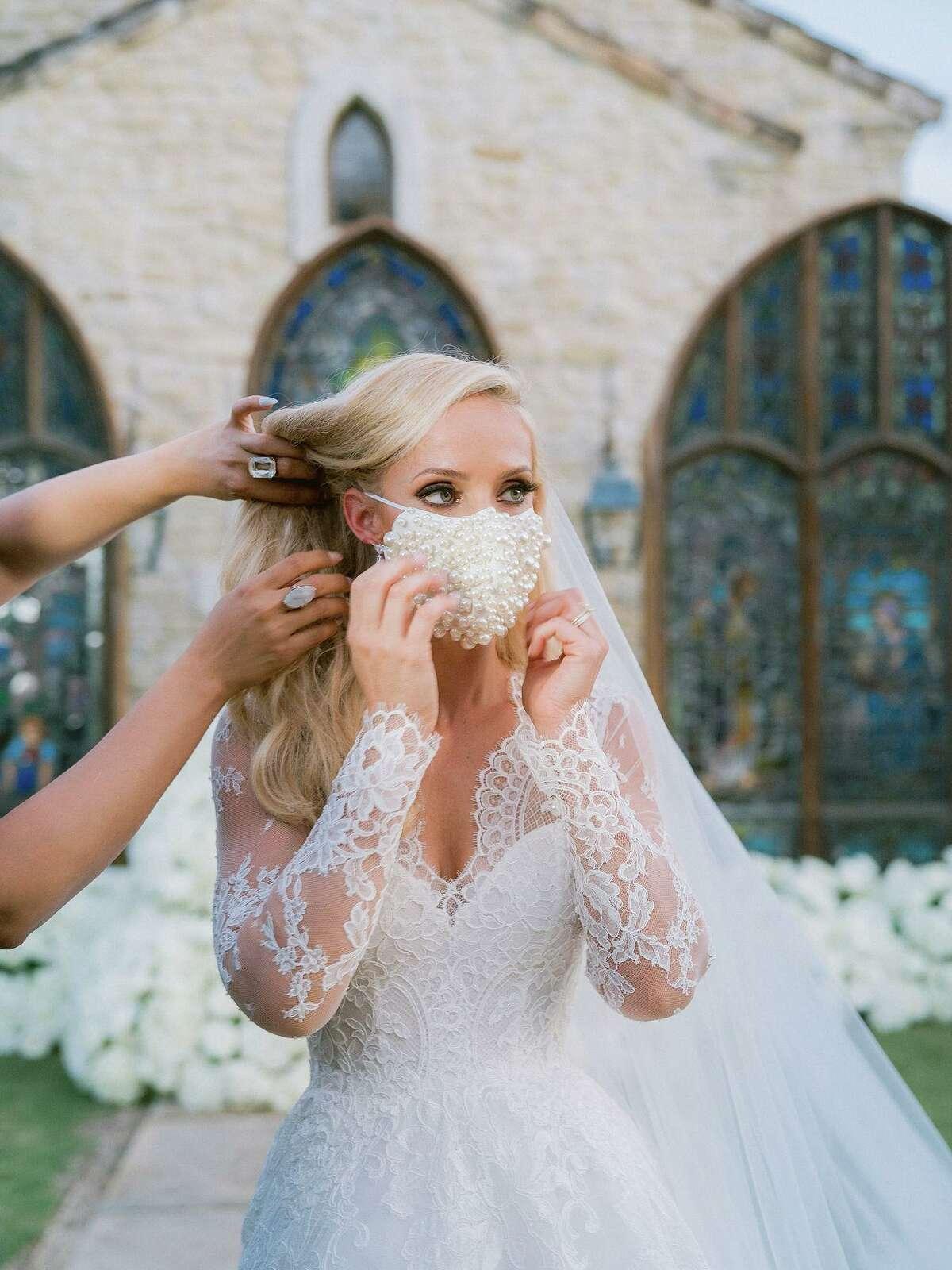 Dr. Elizabeth McIngvale wore a lace face mask at her July wedding. Maison de Carine carries bridal masks, $65, at maisondecarine.com