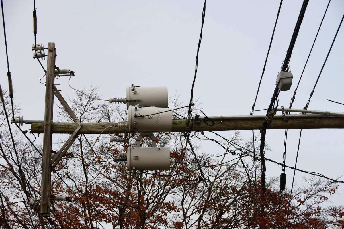 Eversource workers respond to a downed pole
