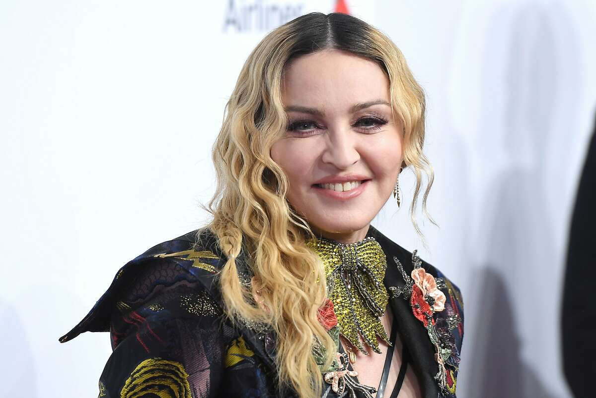 (FILES) In this file photo taken on December 9, 2016 Madonna attends the Billboard Women in Music 2016 event in New York City. - Superstar singer Madonna has been censored on Instagram for spreading false information about a supposed cure for COVID-19 after she shared clips from a video also re-tweeted by Donald Trump. (Photo by ANGELA WEISS / AFP) (Photo by ANGELA WEISS/AFP via Getty Images)
