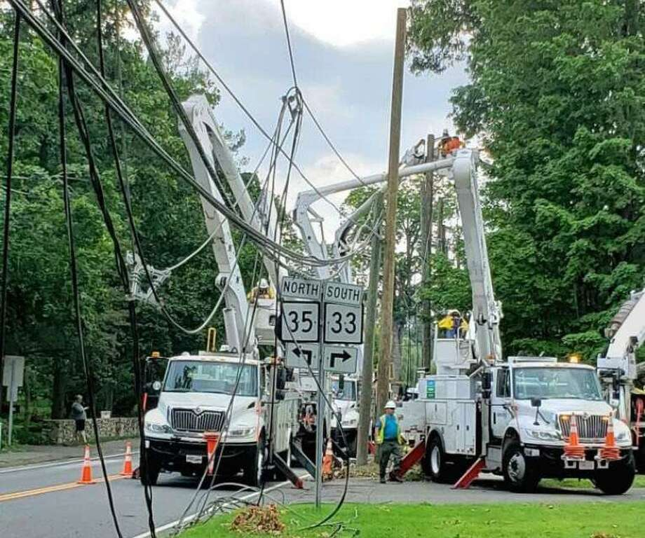 Utility trucks and crews began dealing with a rat's next of wires down near the intersection of Route 33 and 35 in Ridgefield. Photo: Contributed Photo, Hearst Connecticut Media