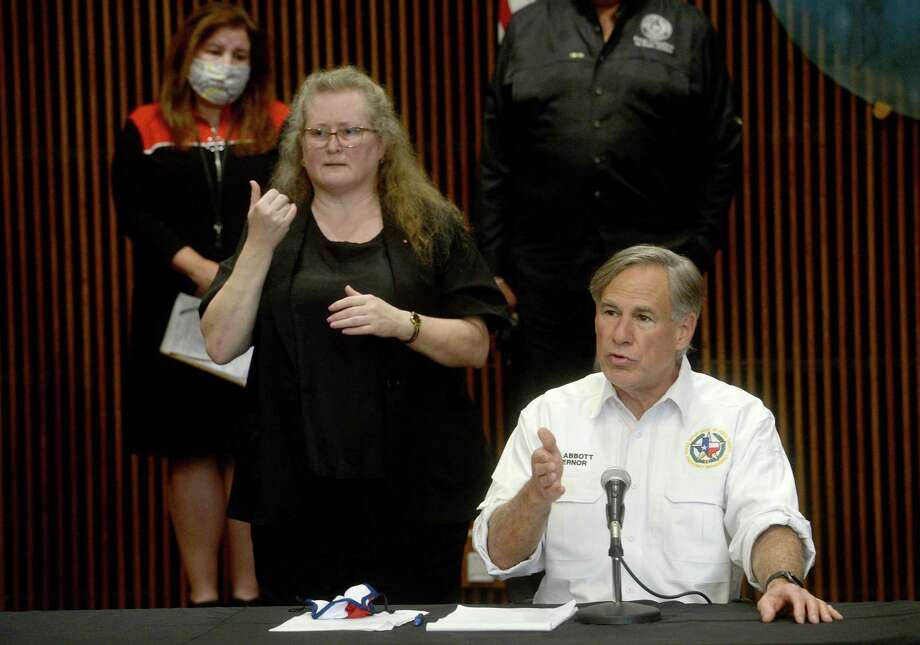 Gov. Abbott speaks during a press conference with officials at the Jefferson County Courthouse to discuss the status of COVID-19 cases in the area, testing, and other issues. Photo: Kim Brent /The Enterprise / BEN