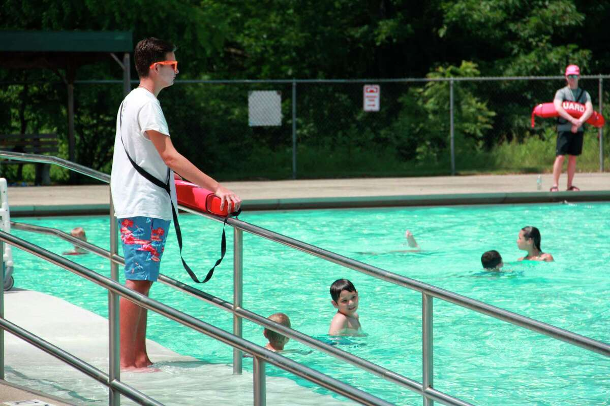 A lifeguard on duty watches swimmers at the Charles E. Fairman Community Pool in Big Rapids. (Pioneer file photo)