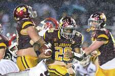 St. Joseph's Jaden Shirden runs for more yardage in the rain against New Canaan in the Dec. 9 CIAC Class L semifinal game. Shirden accounted for 257 yards and five scores to help St. Joseph to victory.