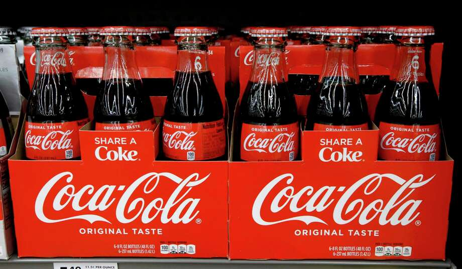"""Coke bottle In August, a former San Antonio man alleged he went to pick up a glass Coca-Cola bottle while shopping in an H-E-B when the container """"suddenly, violently, and without warning, exploded."""" Juan J. Palomo was left with a """"serious injury to his right hand and permanent vision loss to his right eye,"""" according to a lawsuit he filed against H-E-B and Dallas-based Coca-Cola Southwest Beverages. Photo: Gene J. Puskar /Associated Press / Copyright 2018 The Associated Press. All rights reserved."""
