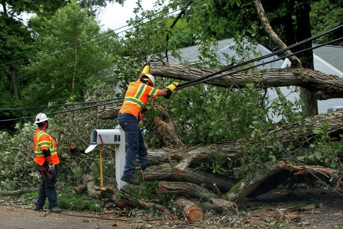 Crews from On Target Utility Service in Maine work to restore power to homes along Gatehouse Road in Trumbull Aug. 7.