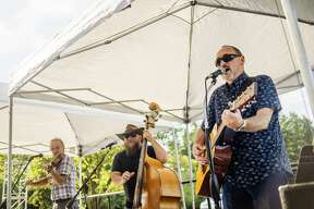 From left, Kirk Dundas, Mike Haines and Albert Lee of the Jack Pack Band perform during a socially distanced Uncorked outdoor happy hour Thursday evening, Aug. 13, 2020 at Midland Center for the Arts. The series will continue every Thursday through September. (Katy Kildee/kkildee@mdn.net)