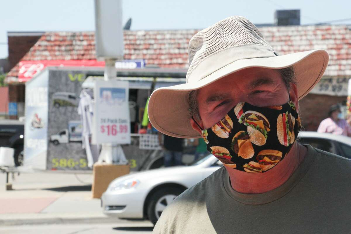 Diehard Parrotheads took to the streets of Caseville on Friday for 'A Slice of Cheeseburger,' a loose-knit celebration of the town's annual festival organized by downtown business owners after the 2020 Cheeseburger in Caseville Festival was canceled by organizers in early June. (Mark Birdsall/Huron Daily Tribune)