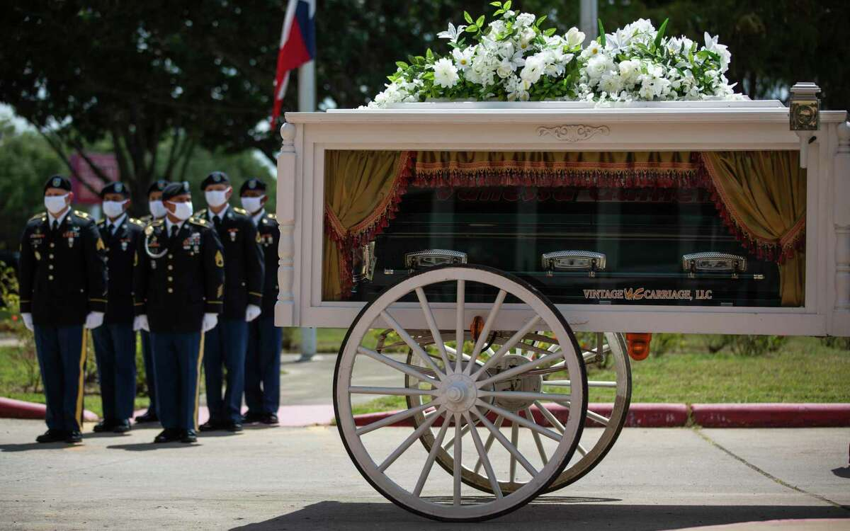The casket of Army Spec. Vanessa Guillén arrives to Chavez High School on Friday, Aug. 14, 2020, in Houston, where she was a student before joining the U.S Army.