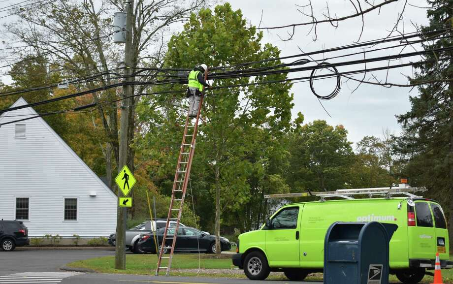File photo showing an Optimum field technician at work in October 2019 in Redding, Conn. Photo: Alexander Soule / Hearst Connecticut Media / Hearst Connecticut Media