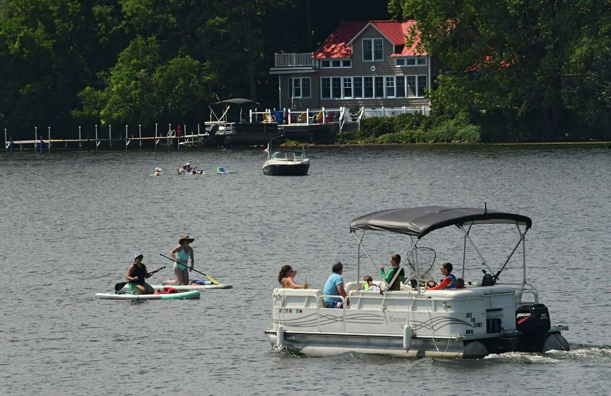 People are seen enjoying Saratoga Lake on Friday, Aug. 14, 2020 in Saratoga Springs, N.Y. (Lori Van Buren/Times Union)