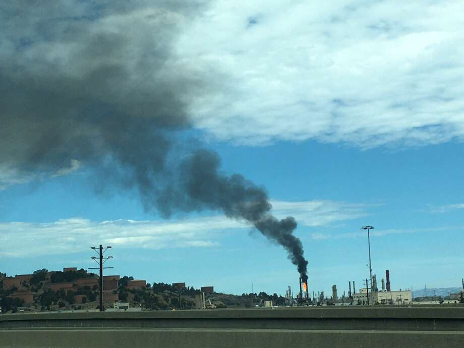 Flaring and smoke at the Chevron refinery in Richmond could be seen in many directions Friday afternoon. Photo: Douglas Zimmerman / SFGATE