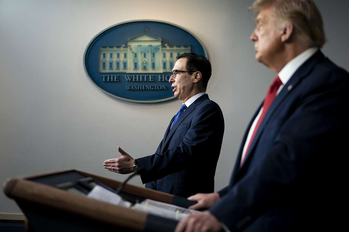Treasury Secretary Steve Mnuchin, left, joins President Donald Trump at a news conference at the White House in Washington, on Monday, Aug. 10, 2020. Providing more aid to struggling state and local governments has become one of the biggest issues tangling up the debate over another pandemic rescue package. (Doug Mills/The New York Times)