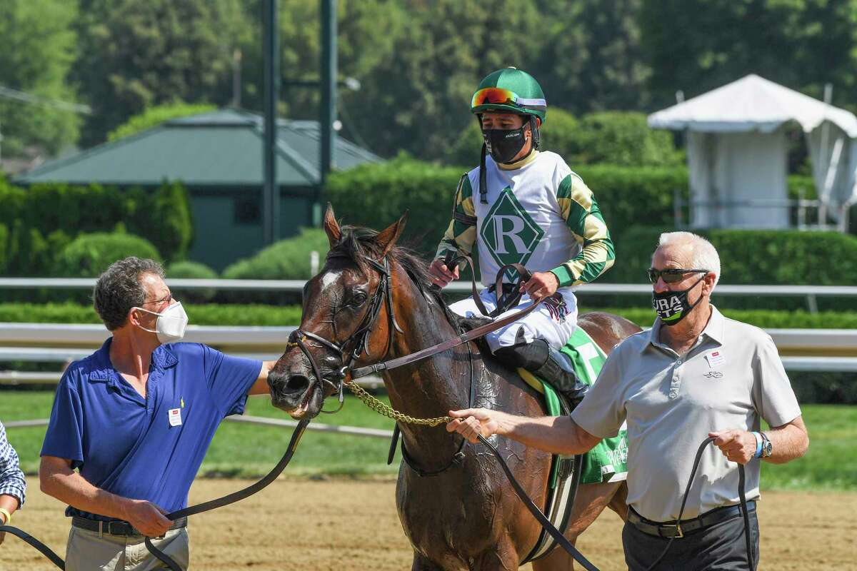 The connections of Feel Glorious ridden by Junior Alvarado takes filly to the winner?•s circle after winning the 7th running of The Perfect Sting Friday Aug.14, 2020 at the Saratoga Race Course in Saratoga Springs, N.Y. Photo by Skip Dickstein/Special to the Times Union