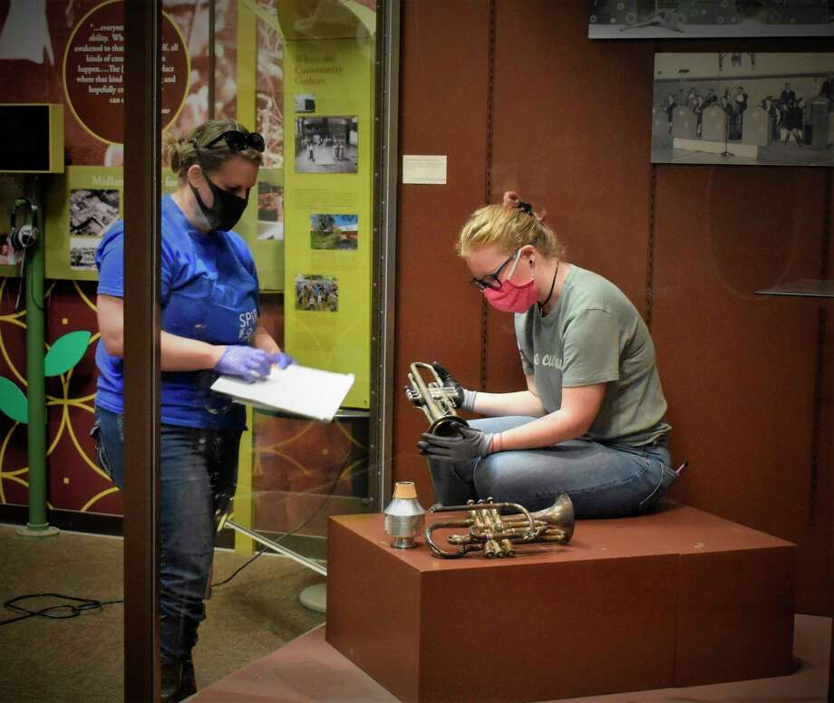 Midland Center for the Arts staff work to sift through artifacts after the flooding in May to determine what can be salvaged from the Herbert H. Doan Midland County History Center and adjacent Heritage Park. (Photo provided/Midland Center for the Arts)