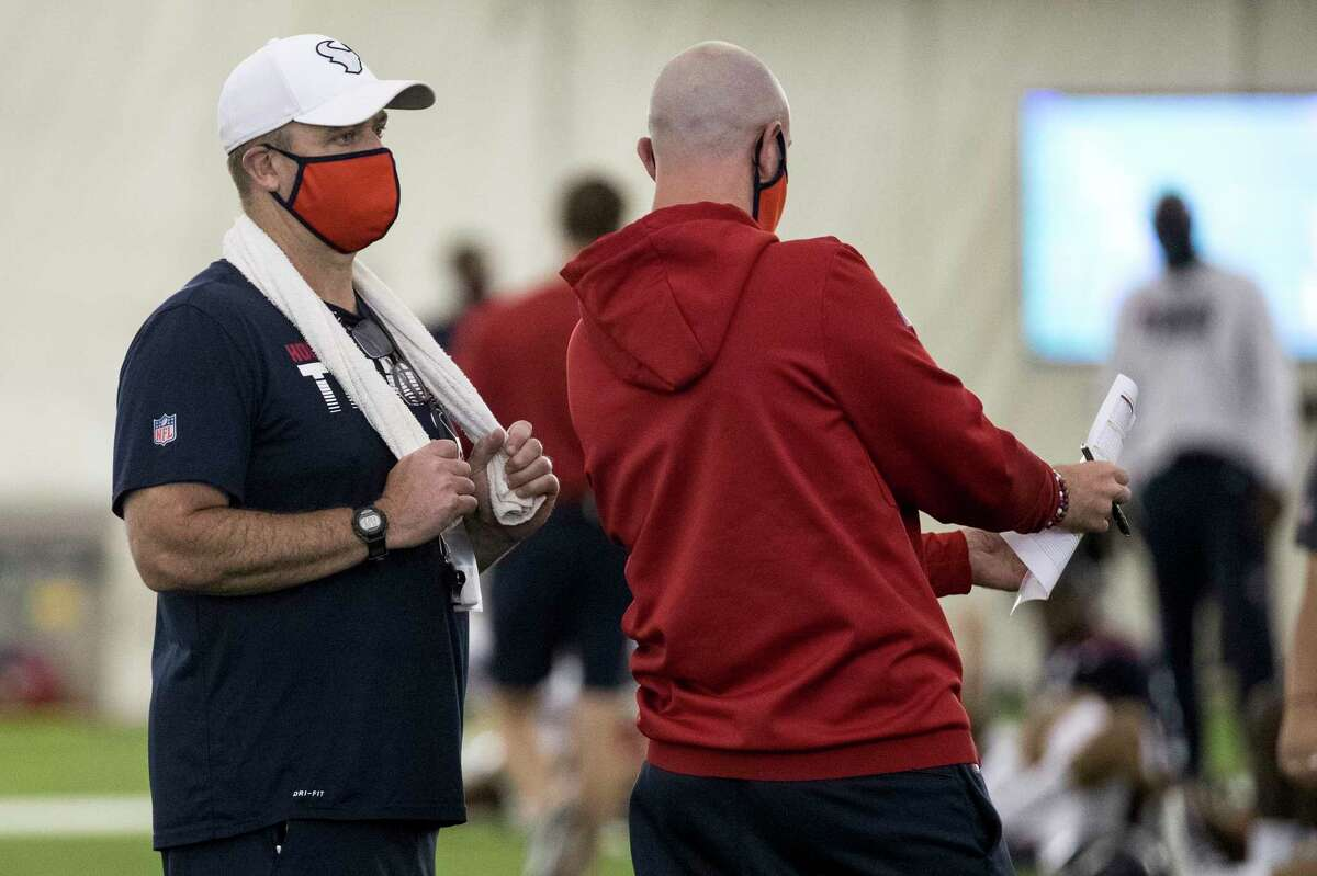 Houston Texans head coach Bill O'Brien, left, and Jack Easterby, executive vice president, football operations, talk during an NFL training camp football practice Friday, Aug. 14, 2020, at The Houston Methodist Training Center in Houston.