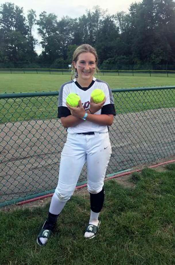 Zoe Taylor poses with the two home-run balls she smacked over the fence. (Courtesy photo/Rodd Taylor)