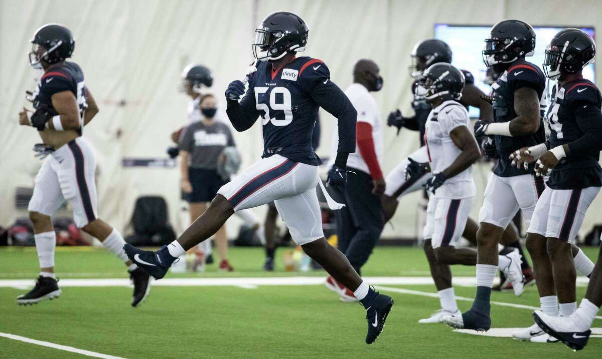 Houston Texans linebacker Whitney Mercilus (59) runs across the field while warming up during an NFL training camp football practice Friday, Aug. 14, 2020, at The Houston Methodist Training Center in Houston.