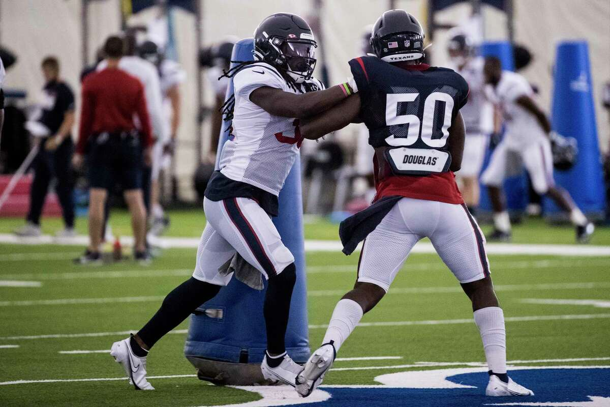 Houston Texans running back Buddy Howell (38) works against linebacker Tyrell Adams (50) during an NFL training camp football practice Friday, Aug. 14, 2020, at The Houston Methodist Training Center in Houston.
