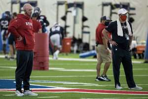 Houston Texans executive vice president, football operations, Jack Easterby, left, and Texans head coach Bill O'Brien watch the team work out during an NFL training camp football practice Friday, Aug. 14, 2020, at The Houston Methodist Training Center in Houston.