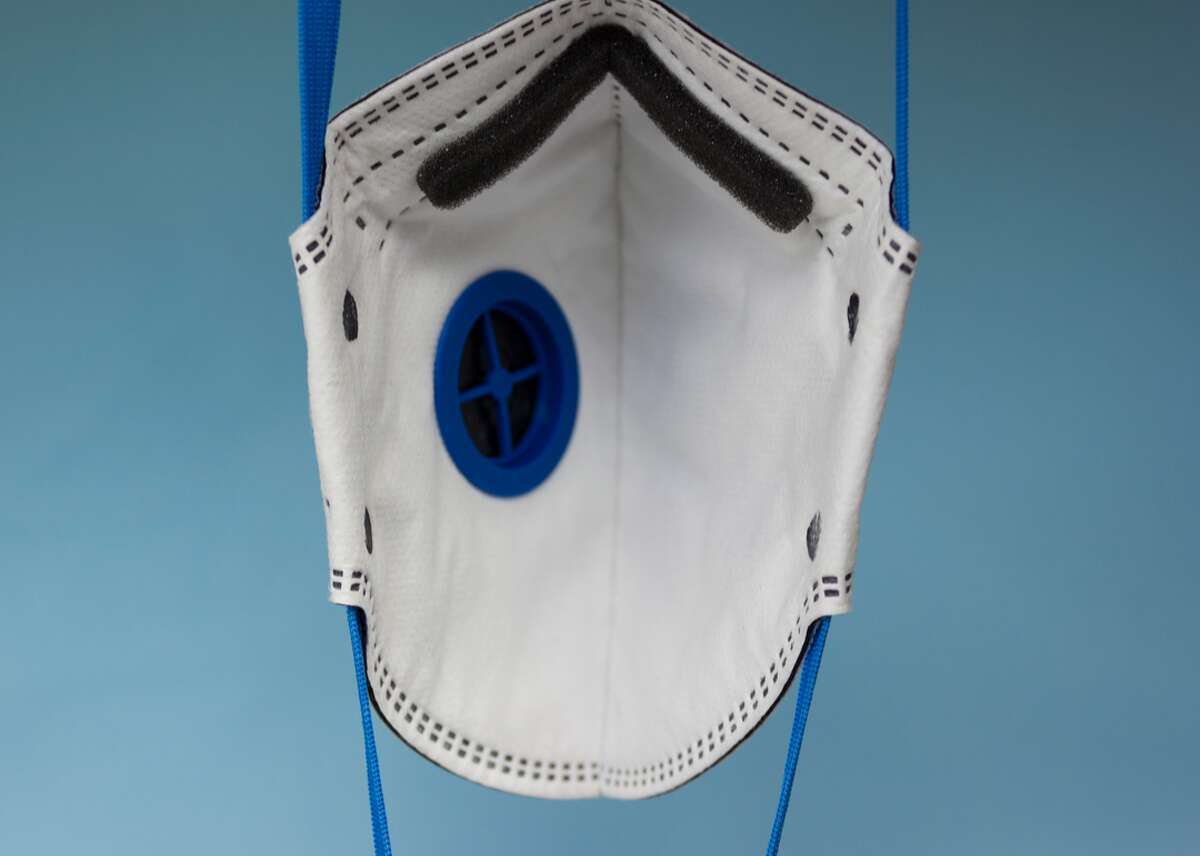 Valved N95 respirator masks do a good job of filtering particulates from wildfire smoke. However, they also allow outward airflow from the wearer to others in his or her vicinity, making them unsuitable as a COVID-19 mask unless the valve is covered.