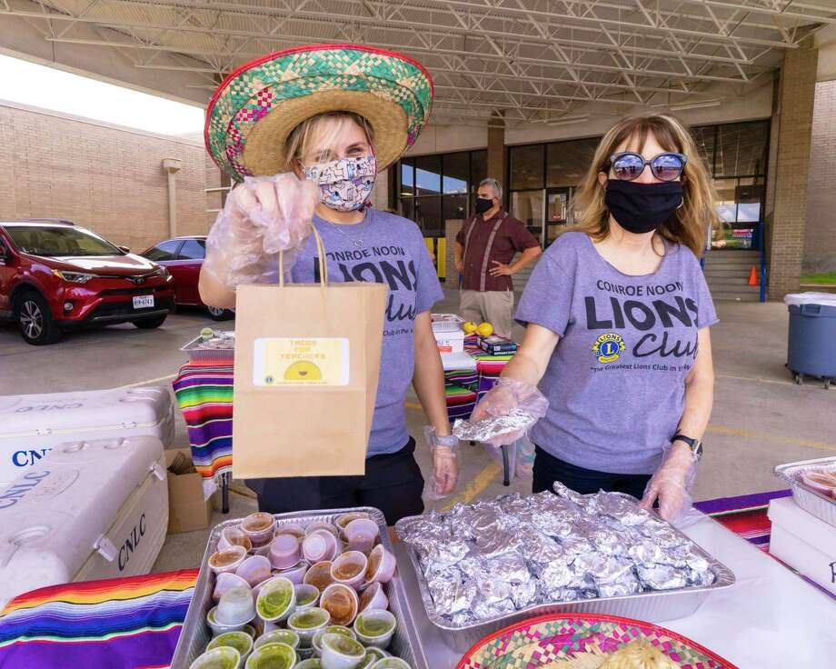 Conroe Noon Lions Club members Amanda Anders, left, and Karen Lonon, right, were busy on the first day of school; handing out tacos to teachers at the club's adopted school Reaves Elementary last week. Photo: Courtesy Photo / constance mcnabb dvm