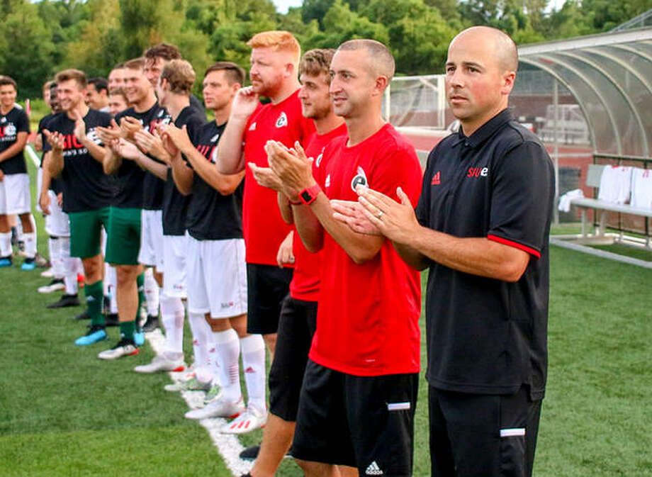 SIUE men's soccer coach Cale Wassermann, right,joins his team in for pregame introductions last season at Korte Stadium. Wassermann's team saw its season cancelled when the Mid-American Conference elected to cancel all fall sports because of the COVID-19 pandemic. No decision had been made yet on moving the season to next spring. Men's soccer is the only sport at SIUE to play in the MAC. Photo: SIUE Athletics
