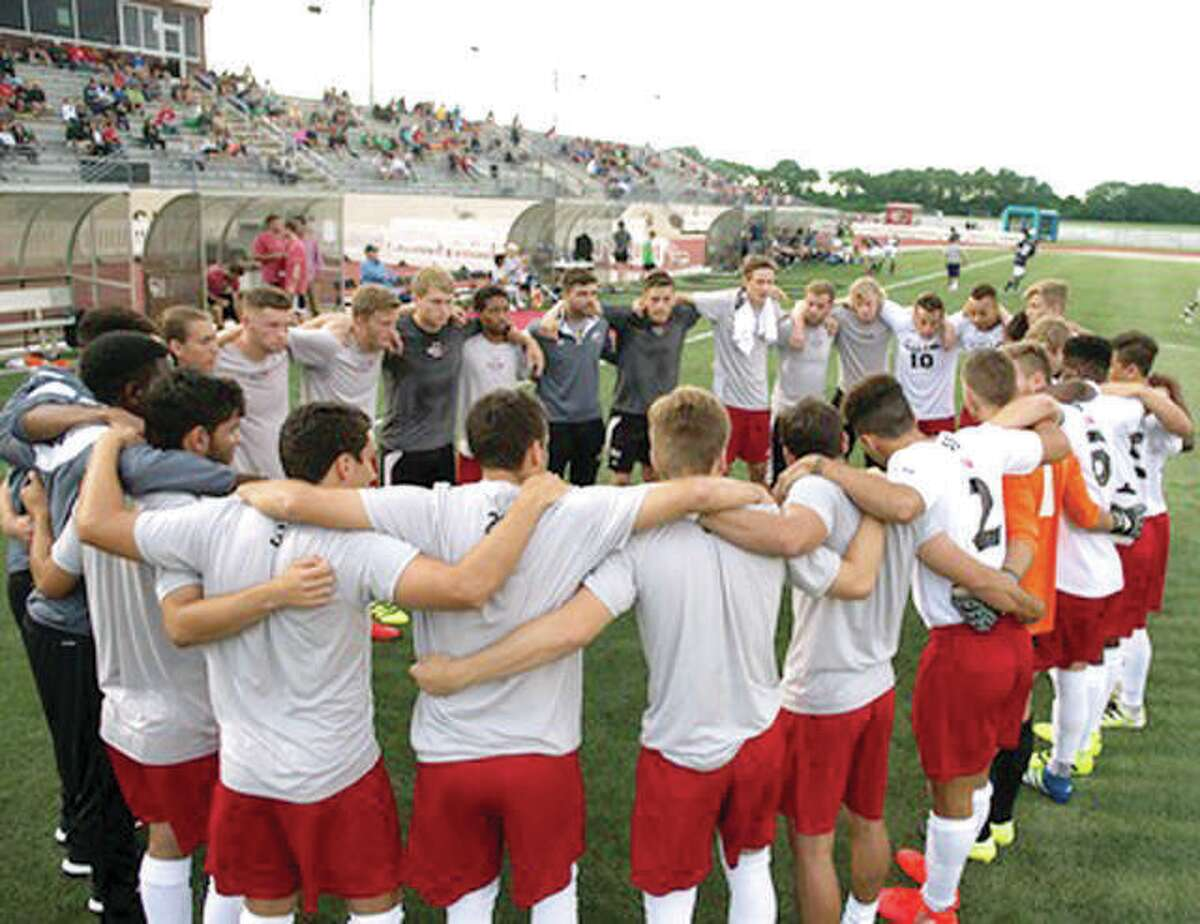 Members of the SIUE men's soccer team huddle before a game against Notre Dame.
