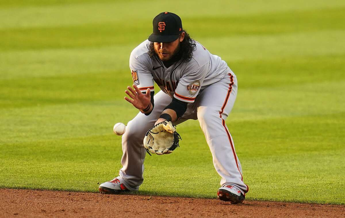 San Francisco Giants shortstop Brandon Crawford catches a ground ball hit by Colorado Rockies' Raimel Tapia during the second inning of a baseball game, Wednesday, Aug. 5, 2020, in Denver. (AP Photo/Jack Dempsey)