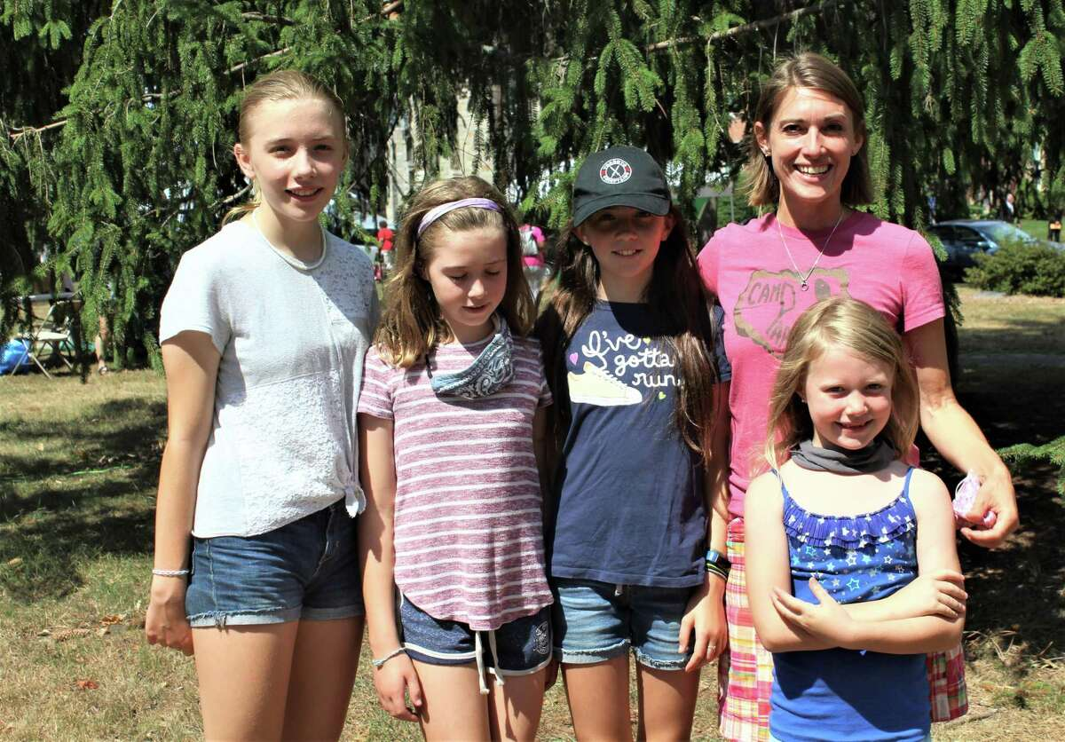 Many turned out Friday for the Middletown Farmers Market on the South Green. Shown here the McKenna family Irish step dancers, from left, Ailish, 13, Bronagh, 11, Clare, 9, mother Marie, and Deirdre, 6, who gave an impromptu demonstration of their skills.