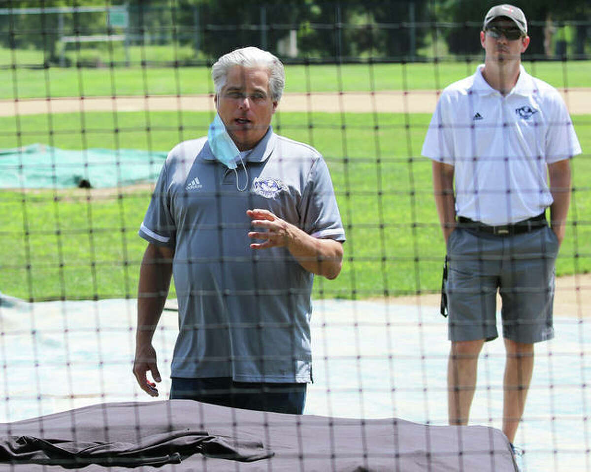 Alton mayor Brant Walker (left), with the city's Park and Rec executive director Michael Haynes looking on, welcomes the River Dragons to Alton as a press conference Friday afternoon at Hopkins Field inside Gordon Moore Park.