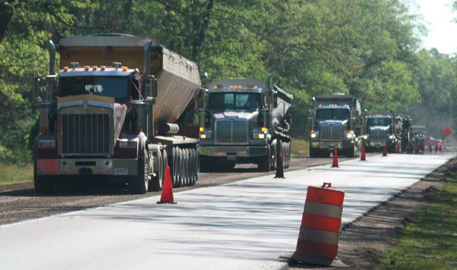 Work continued Friday on the Michigan Department of Transportation's road reconstruction project on M-55 east of Claybank Road. (Kyle Kotecki/News Advocate)