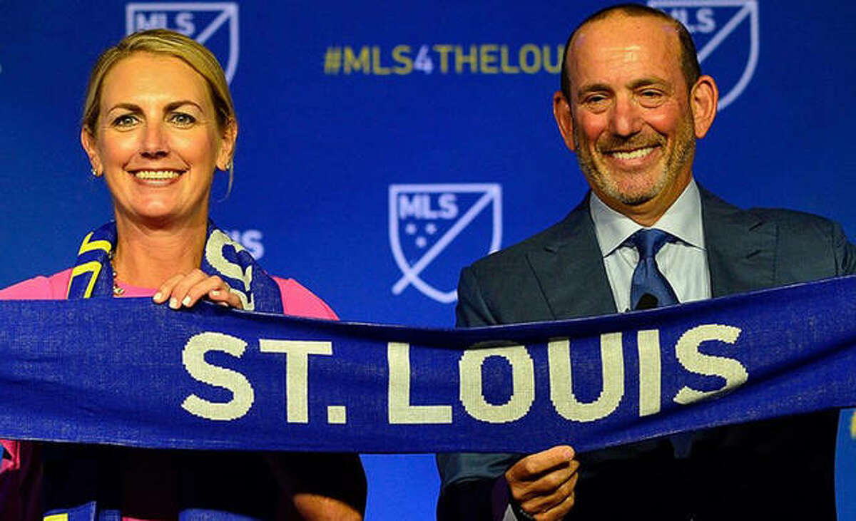St. Louis City SC owner Carolyn Kindle Betz is joined by MLS commissioner Don Garber during last August's announcement that St. Louis would receive an MLS expansion team. Thursday, the team's name, St. Louis City SC, along with its team crest and colors were announced at a virtual ceremony.