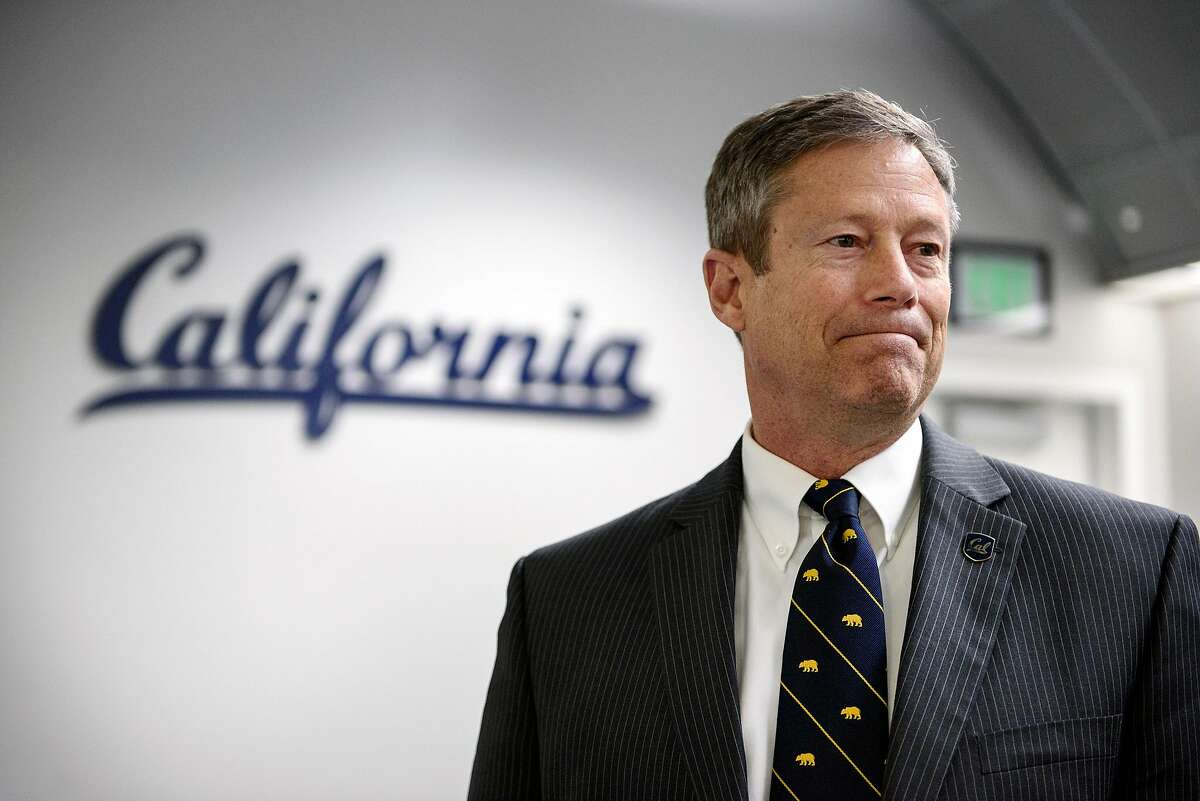 """Director of Athletics Jim Knowlton talks with reporters following a press conference announcing that the """"Big Game"""" versus Stanford University is canceled due to poor air quality, held on the Cal campus in Berkeley, California, on Friday, November 16, 2018."""