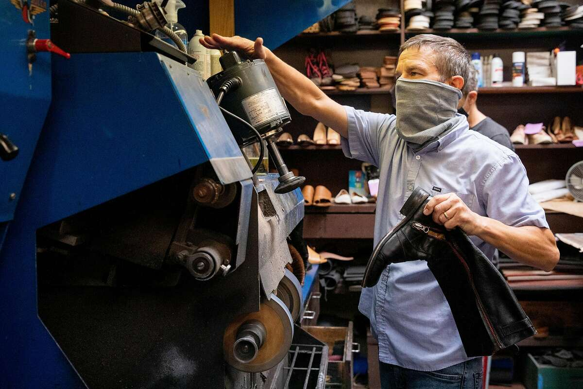 Steve Oberhauser wears a mask while working on shoes inside The Cobblery in Palo Alto, Calif. Tuesday, August 11, 2020. The current pandemic-fueled financial crisis is exacerbating existing mental health disorders for those who have them and causing anxiety and depression for many for the first time, including small business owners struggling with financial devastation. Oberhauser and his family own The Cobblery, a shoe repair shop, and has shared the toll financial devastation has taken on his mental health.