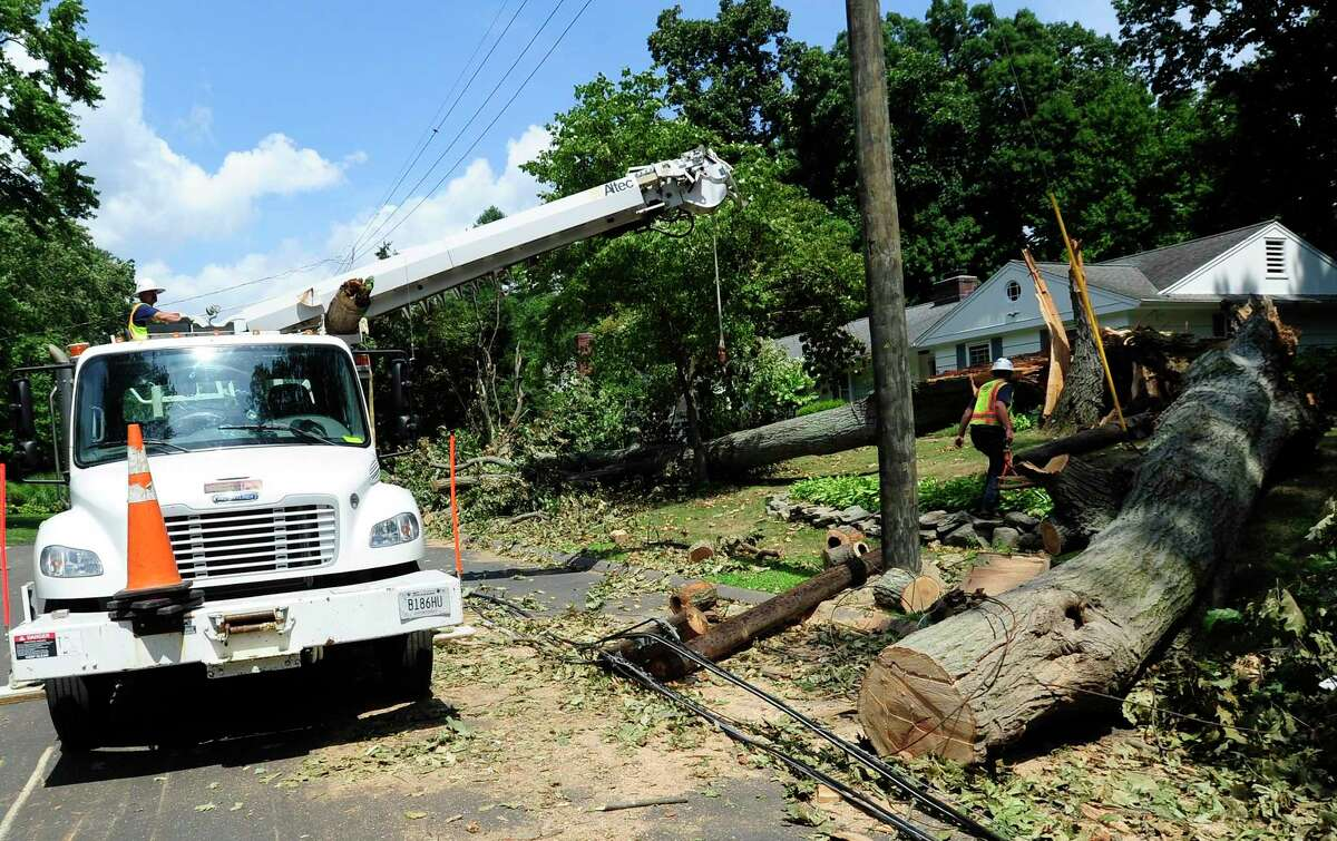 A utility crew works on an line failure on Aug. 11, 2020, in Stamford, Conn.