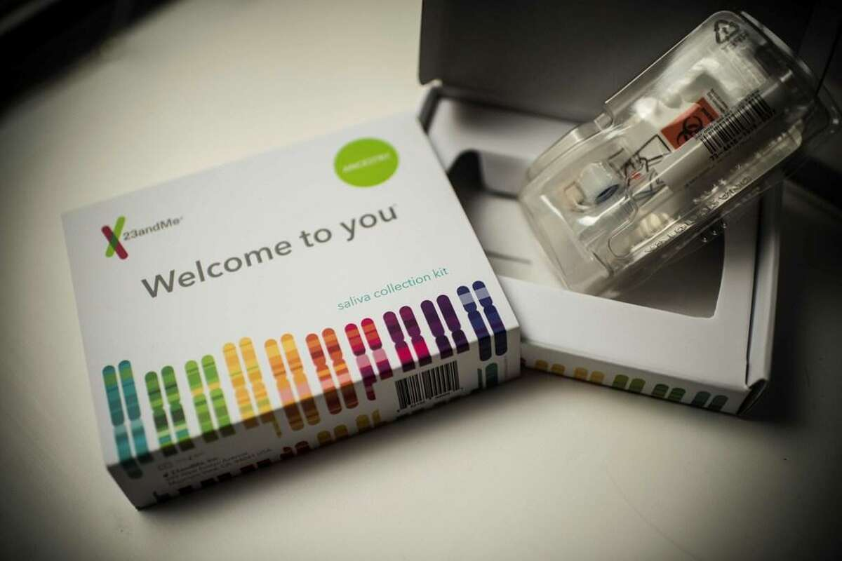 This illustration picture shows a saliva collection kit for DNA testing displayed in Washington DC on December 19, 2018. Between 2015 and 2018, sales of DNA test kits boomed in the United States and allowed websites to build a critical mass of DNA profiles. The four DNA websites that offer match services - Ancestry, 23andMe, Family Tree DNA, My Heritage - today have so many users that it is rare for someone not to find at least one distant relative.