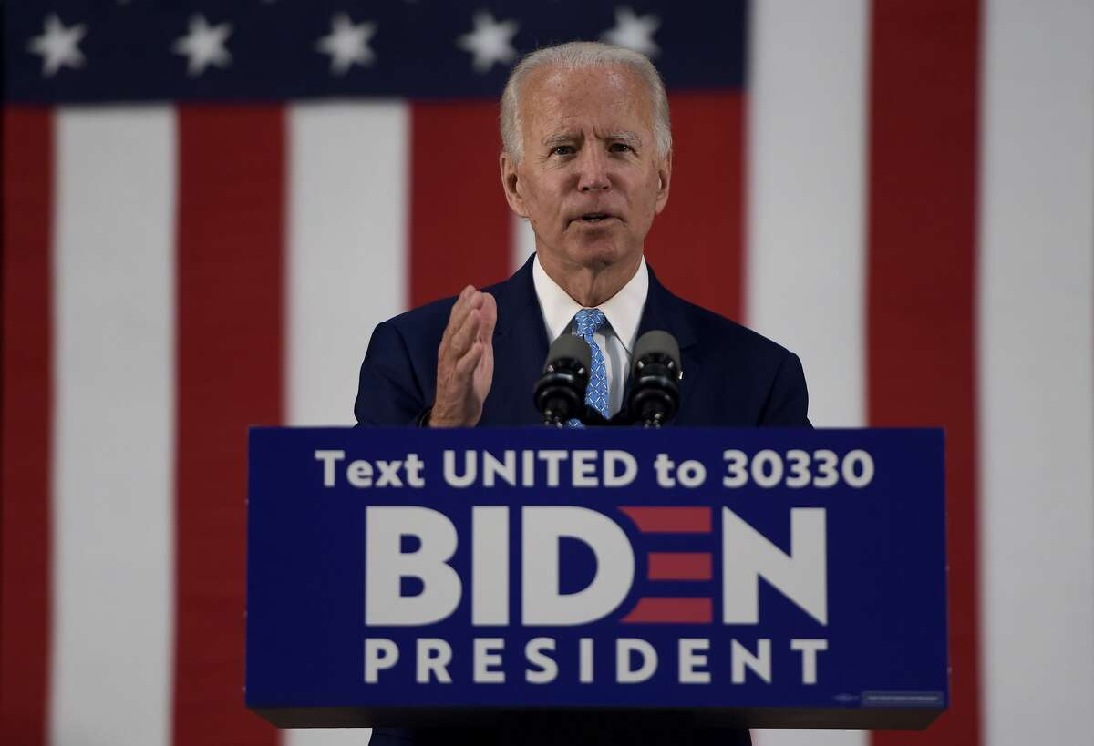 (FILES) In this file photo taken on June 30, 2020 US Democratic presidential candidate Joe Biden speaks in Wilmington, Delaware. - Joe Biden will not attend the Democratic convention to accept the party's nomination to be its presidential election candidate after the event was further scaled back due to the coronavirus pandemic, officials said August 5, 2020. Biden
