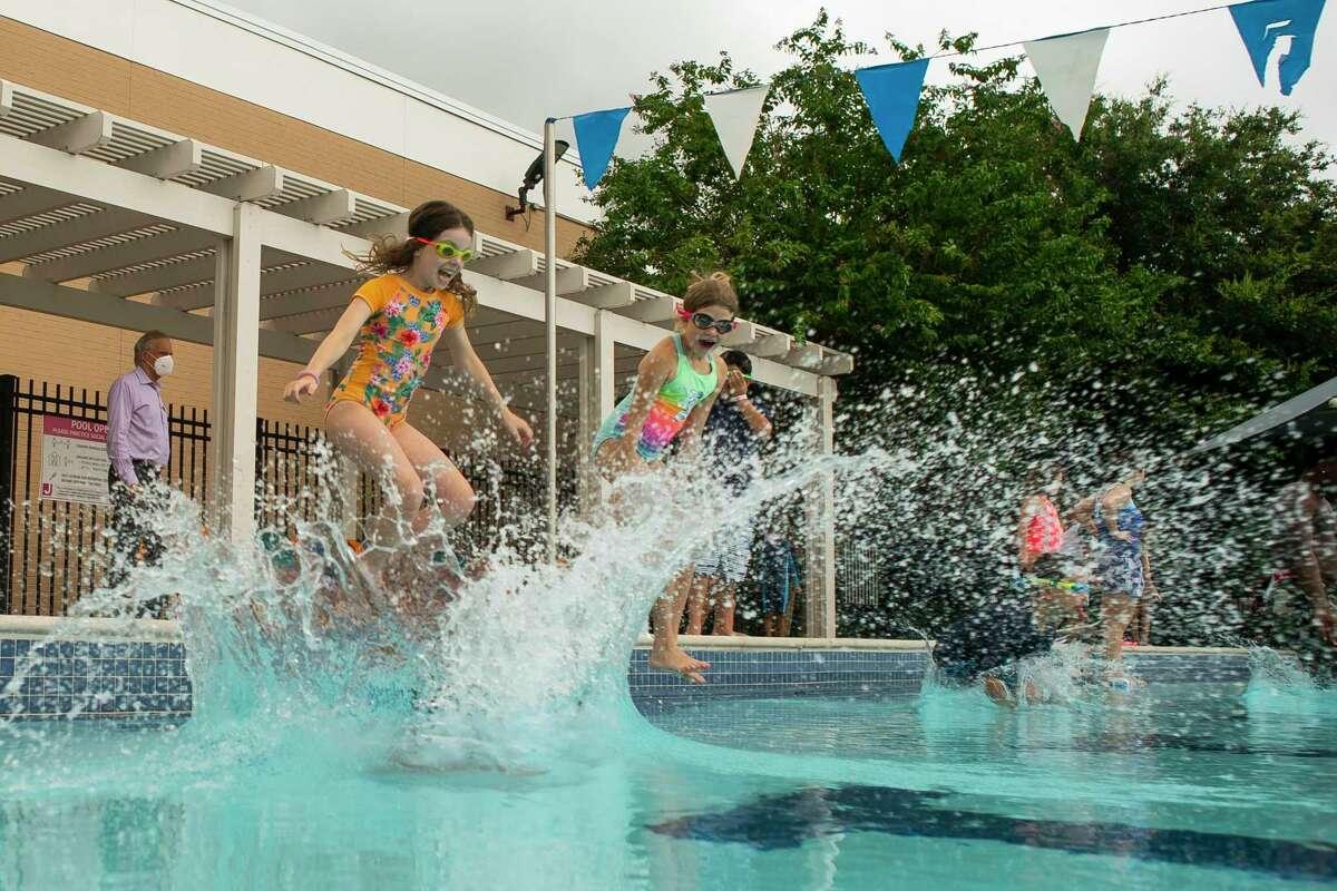 Children of essential workers swim during summer camp at the Evelyn Rubenstein Jewish Community Center in Houston.