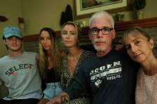 Wally and Niki Beddoe with their children from left; Kirk, 22, Amy, 16, and Carly, 26, at their home in Trumbull, Conn. on Tuesday, August 11, 2020. The Beddoe's recently lost their 25-year-old son and brother, Jake, from accidental fentanyl ingestion.