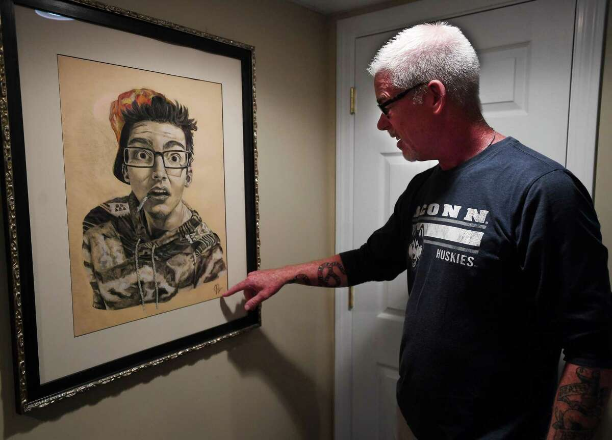 Wally Beddoe shows off a self portrait drawn by his son Jake at his home in Trumbull, Conn. on Tuesday, August 11, 2020. Jake Beddoe recently passed awayfrom accidental fentanyl ingestion.