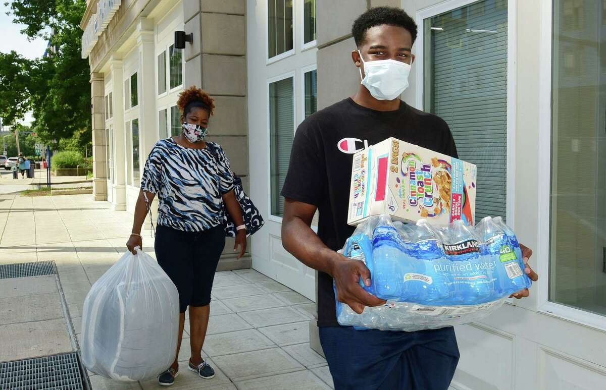 About 265 Stamford UCONN students including Curtis Morrison move into the 900 Washington BLVD residence hall Friday, August 14, 2020, in Stamford, Conn. Students received specific arrival times to help stagger the amount of people in each building at any particular time as part of a COVID protocol. About 5,500 students will be moving into Storrs residence halls Friday through Monday.
